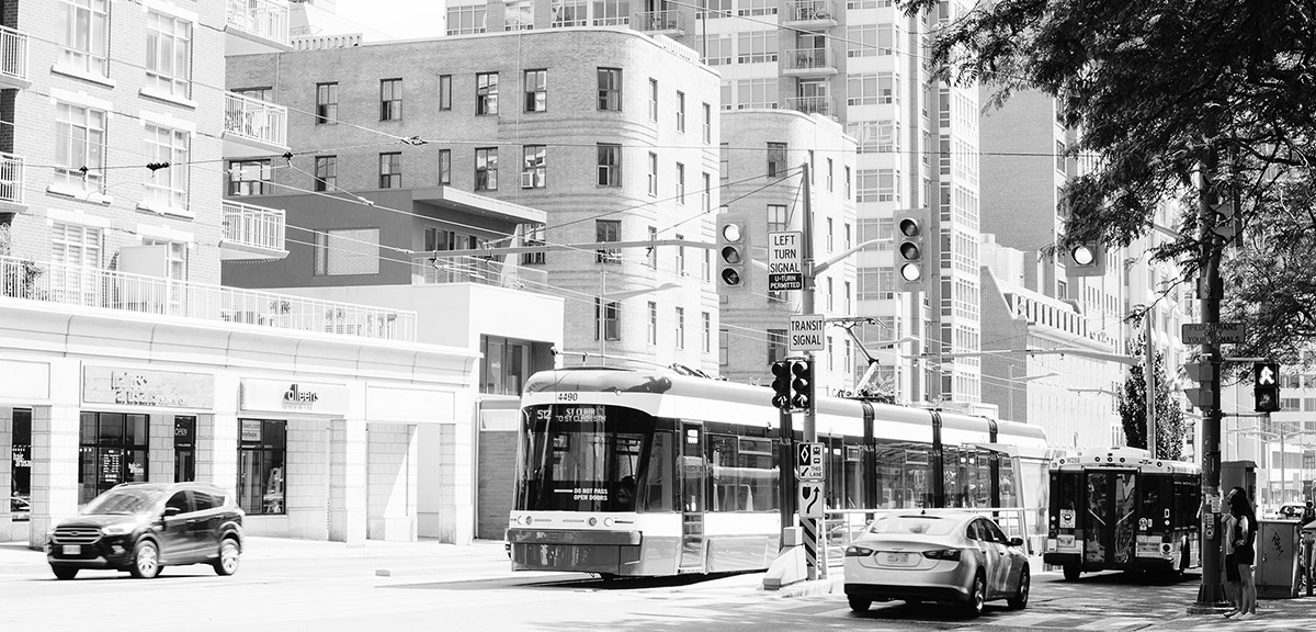 The St. Clair Avenue streetcar travelling through traffic in Toronto, Ontario.