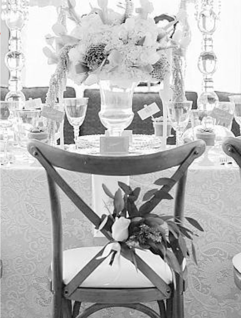 An event table setting with Chair-man Mills–supplied rental items.